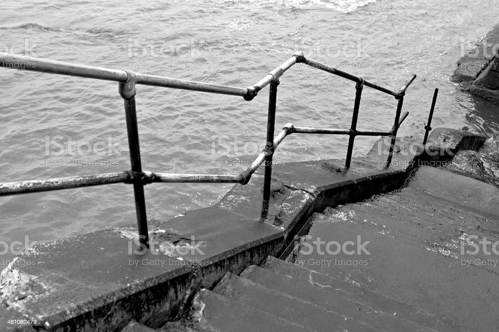 Wet stone steps and railing stock photo