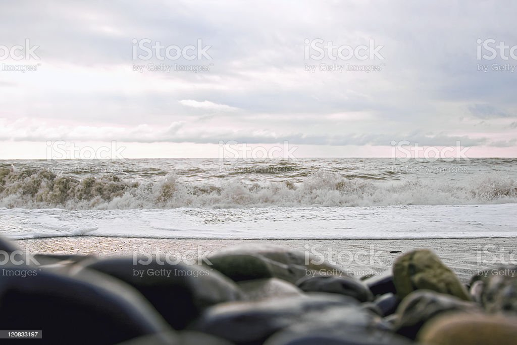 Wet stones on the beach in a storm royalty-free stock photo