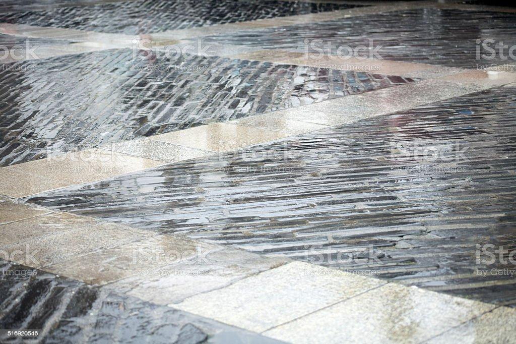 Wet street tiled floor stock photo