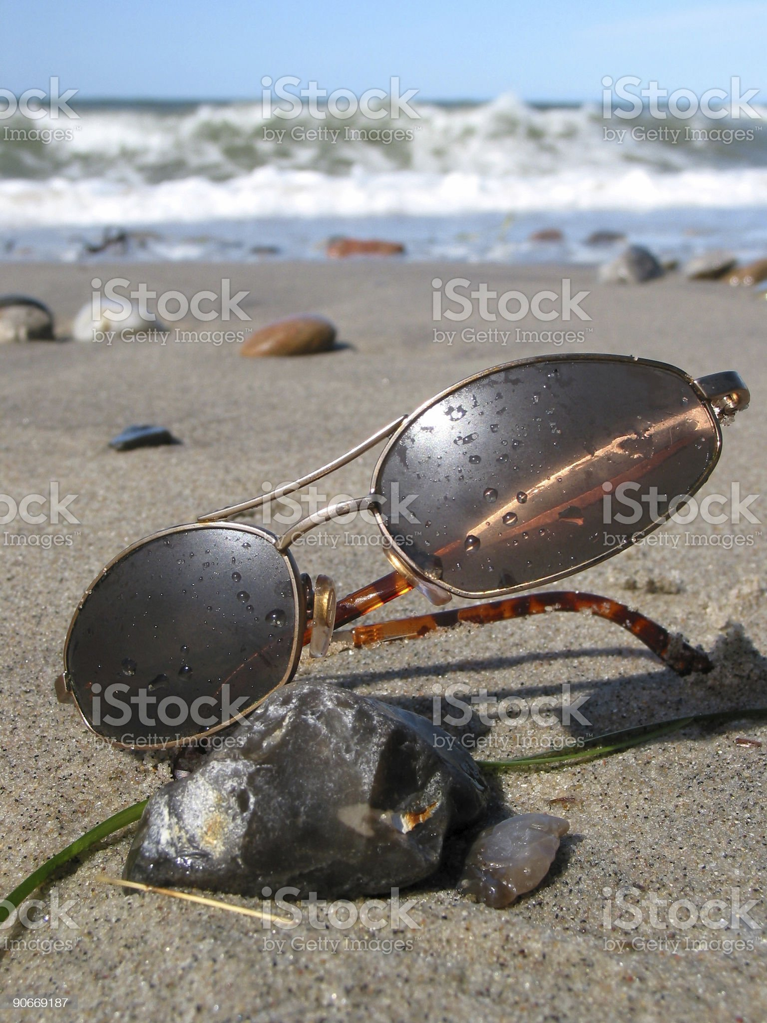 Wet sunglasses on the beach royalty-free stock photo