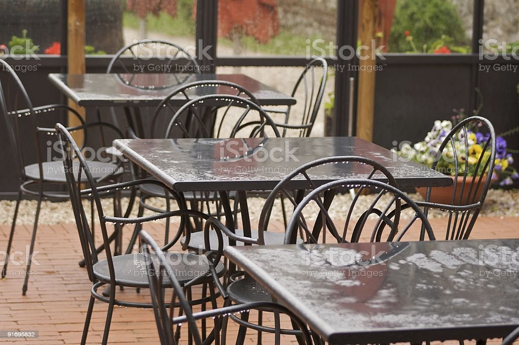 Wet tables under the rain in a Castle stock photo