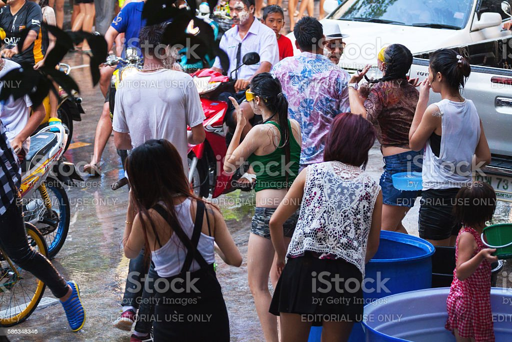 Wet thai people and street at Songkran stock photo
