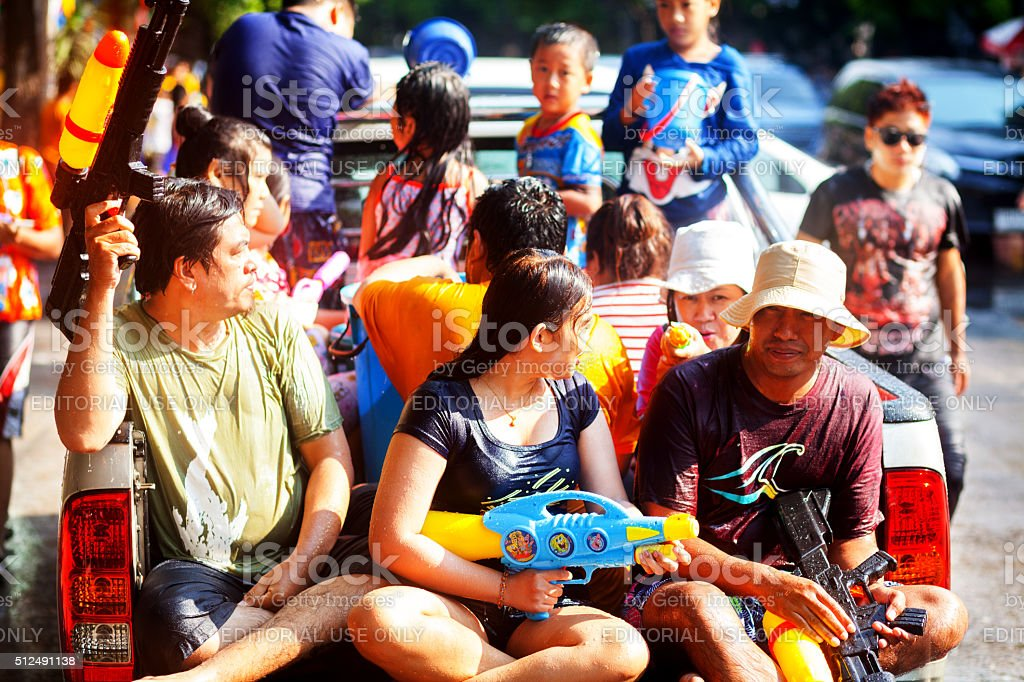 Wet Thai people on pickup at Songkran stock photo