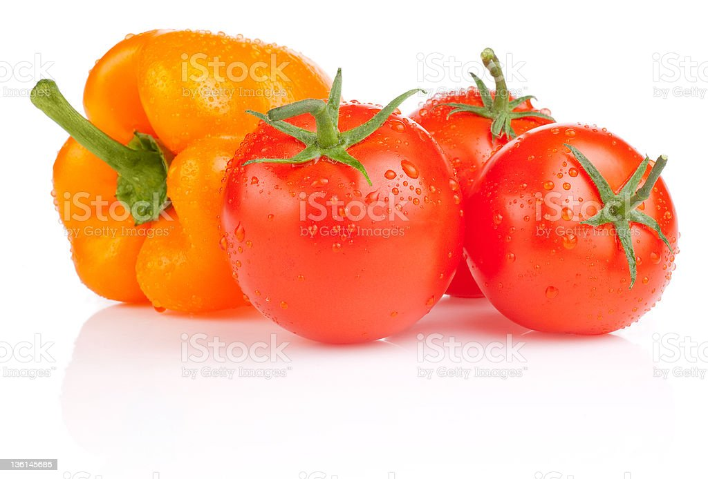 Wet Tomatoes and Yellow Bell Pepper with drops isolated royalty-free stock photo