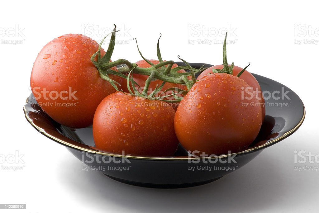 Wet tomatoes in a bowl royalty-free stock photo