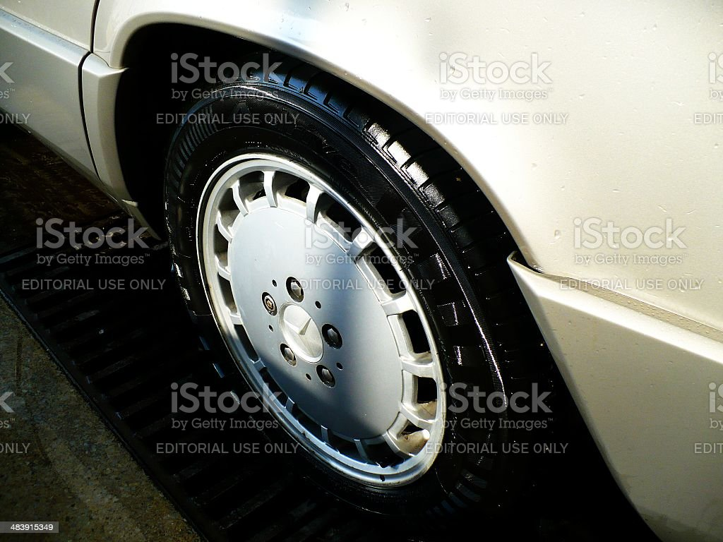 Wet tyre of Mercedes 190E (W201) royalty-free stock photo