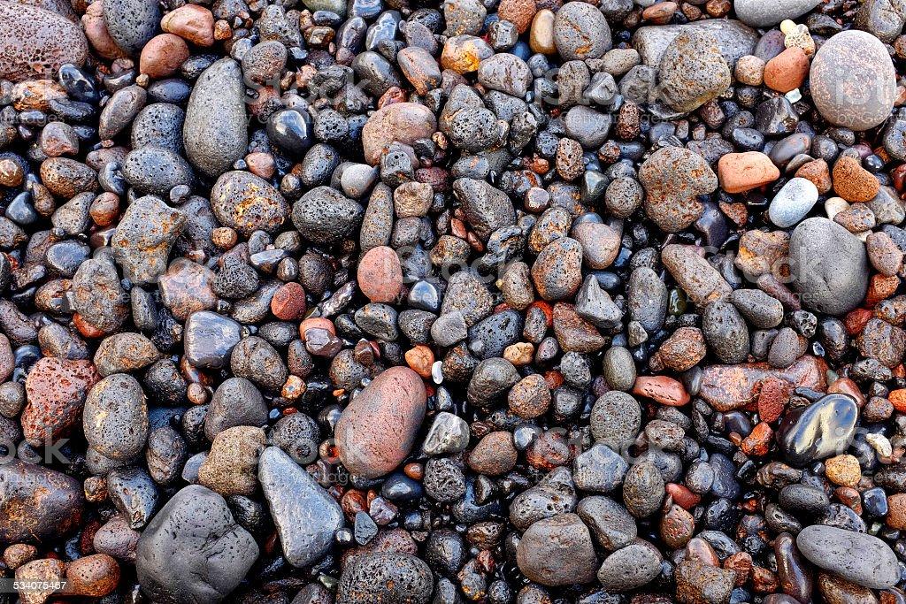 Wet volcanic pebbles stock photo