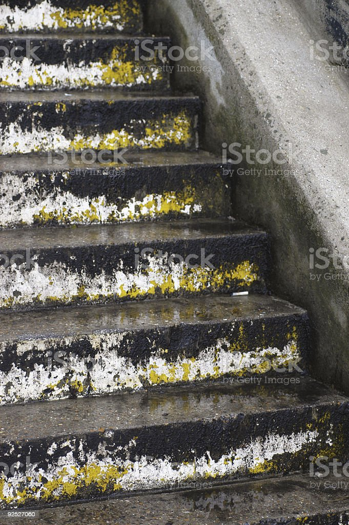 Wet weathered grungy concrete steps royalty-free stock photo
