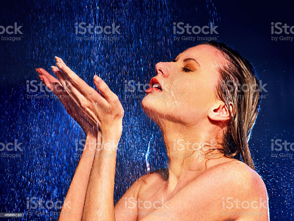 Wet woman face with water drop stock photo