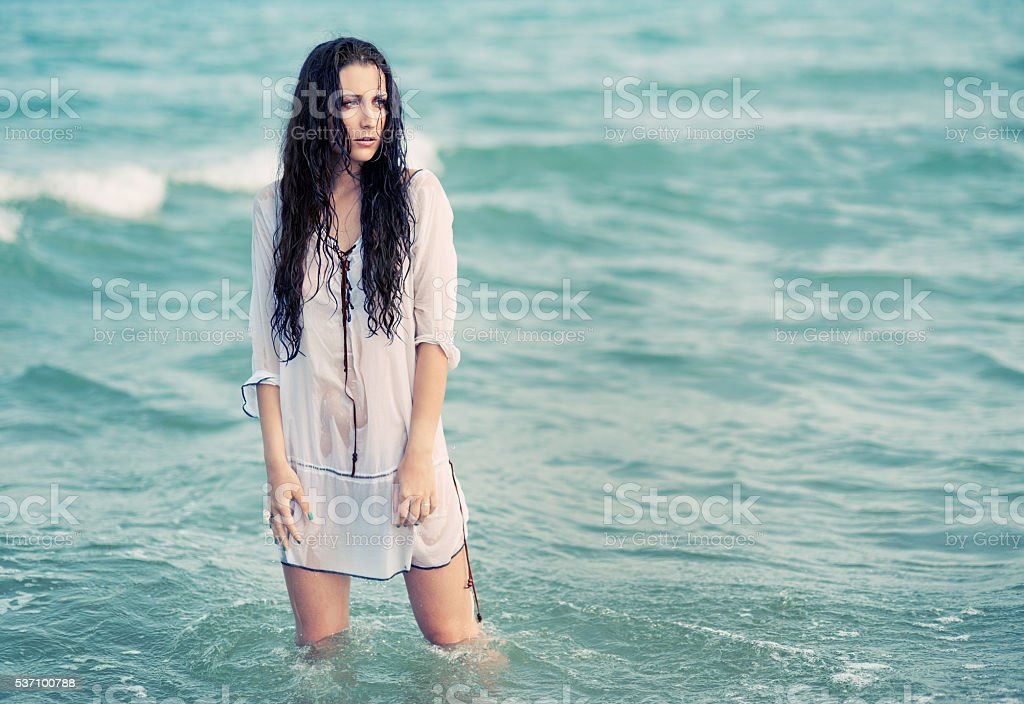 Wet woman model in the sea stock photo