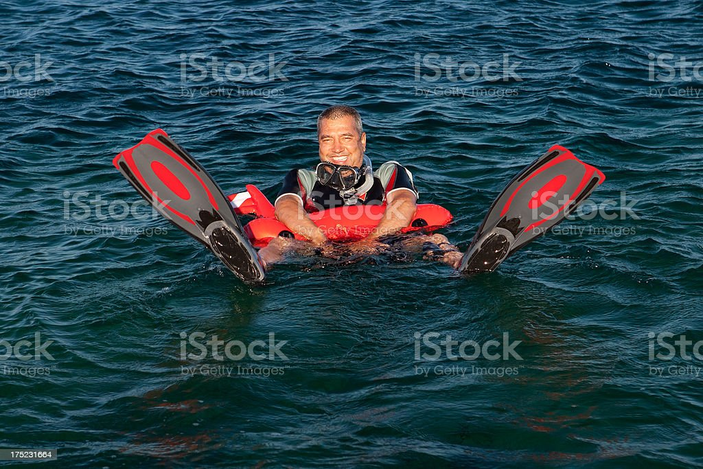 Wetsuit wore man Happy with buoy royalty-free stock photo