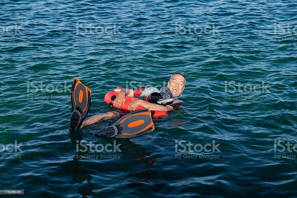 Wetsuit wore man yelling for assistance royalty-free stock photo
