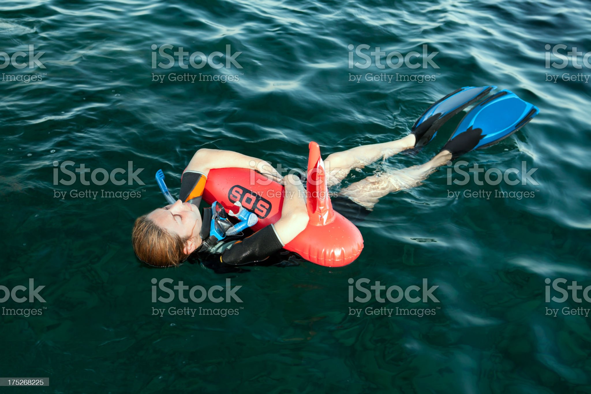 Wetsuit wore women holding a s.o.s. buoy royalty-free stock photo