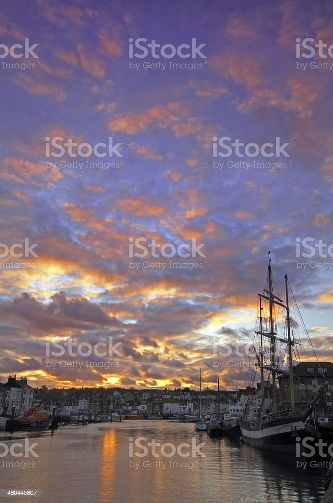 Weymouth harbour at sunset stock photo