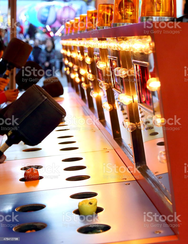 Whacking game at carnival stock photo