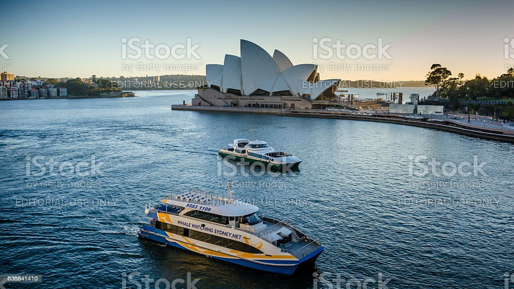 Whale-watching boat sails past Sidney Opera House stock photo