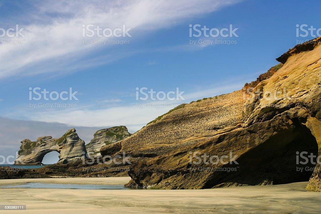 Wharariki beach, New Zealand. View to Archway Islands rocks stock photo