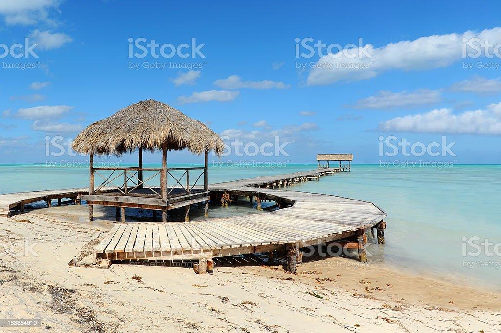 wharf at tropical beach stock photo