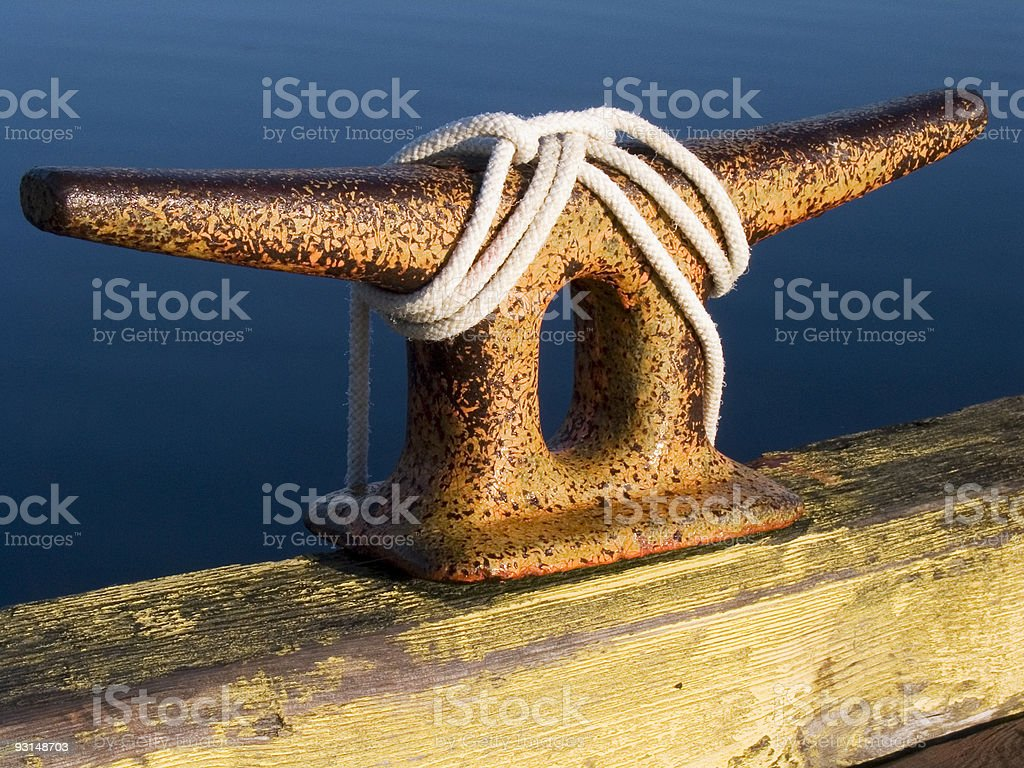 wharf tie cleat with rope royalty-free stock photo