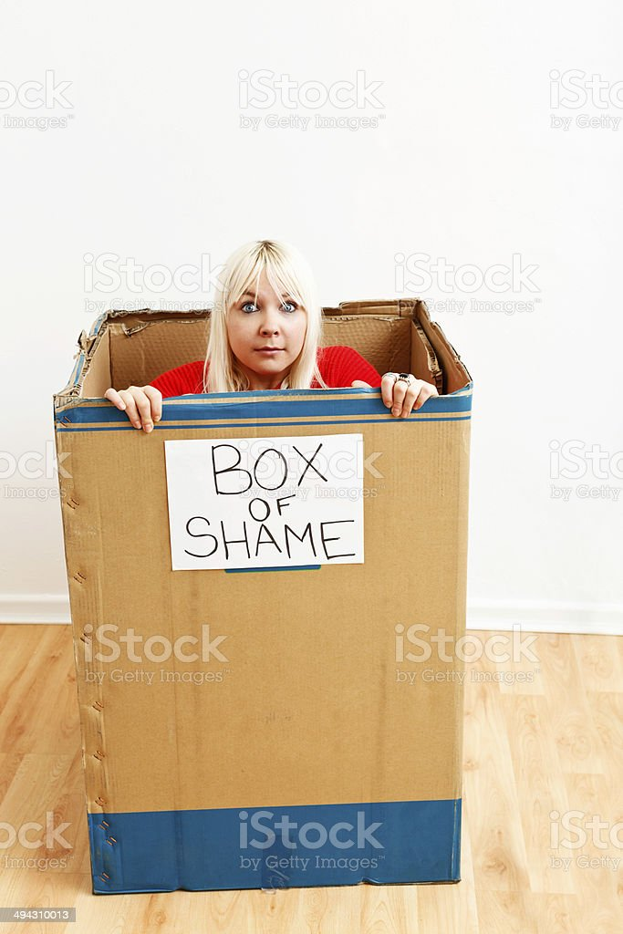 What am I doing here? Startled blonde being unjustly punished stock photo