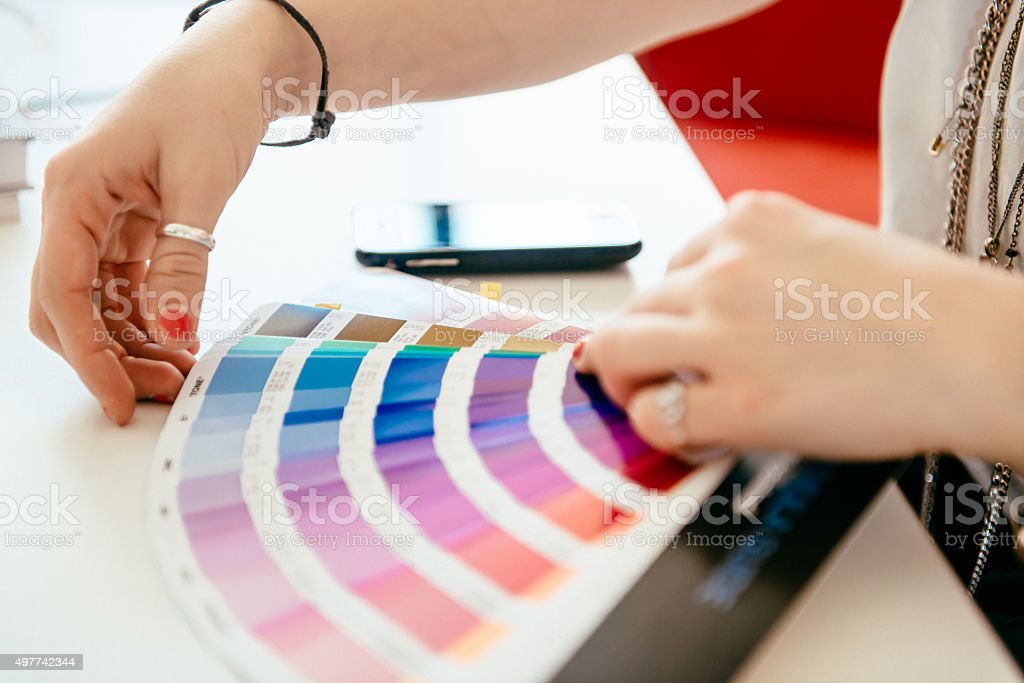 What Color To Choose? Designer With Color Fan stock photo