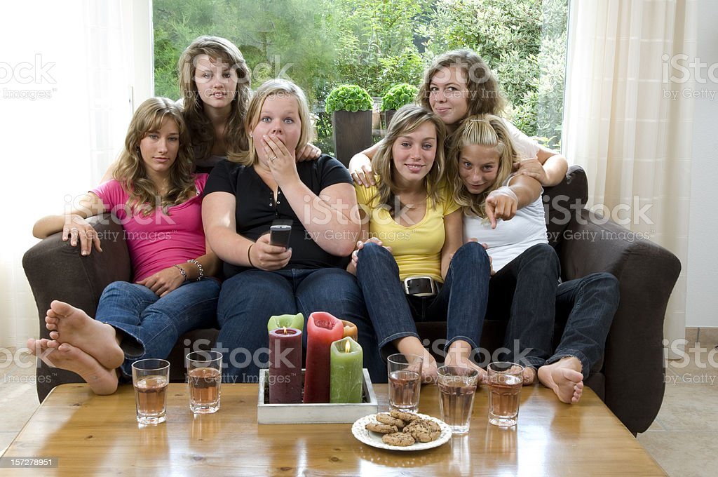 what is on the tv girls royalty-free stock photo