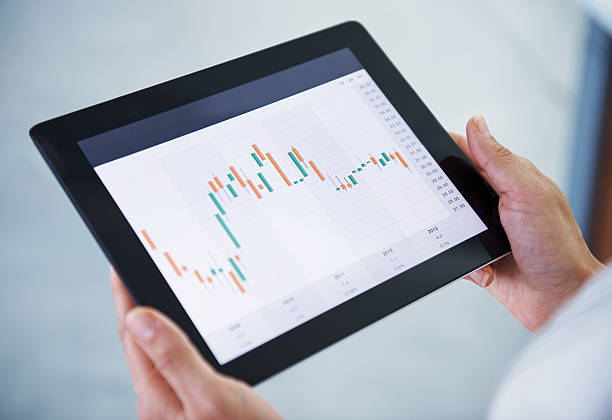 Holding Touch Screen Tablet And With Graph Pictures Images