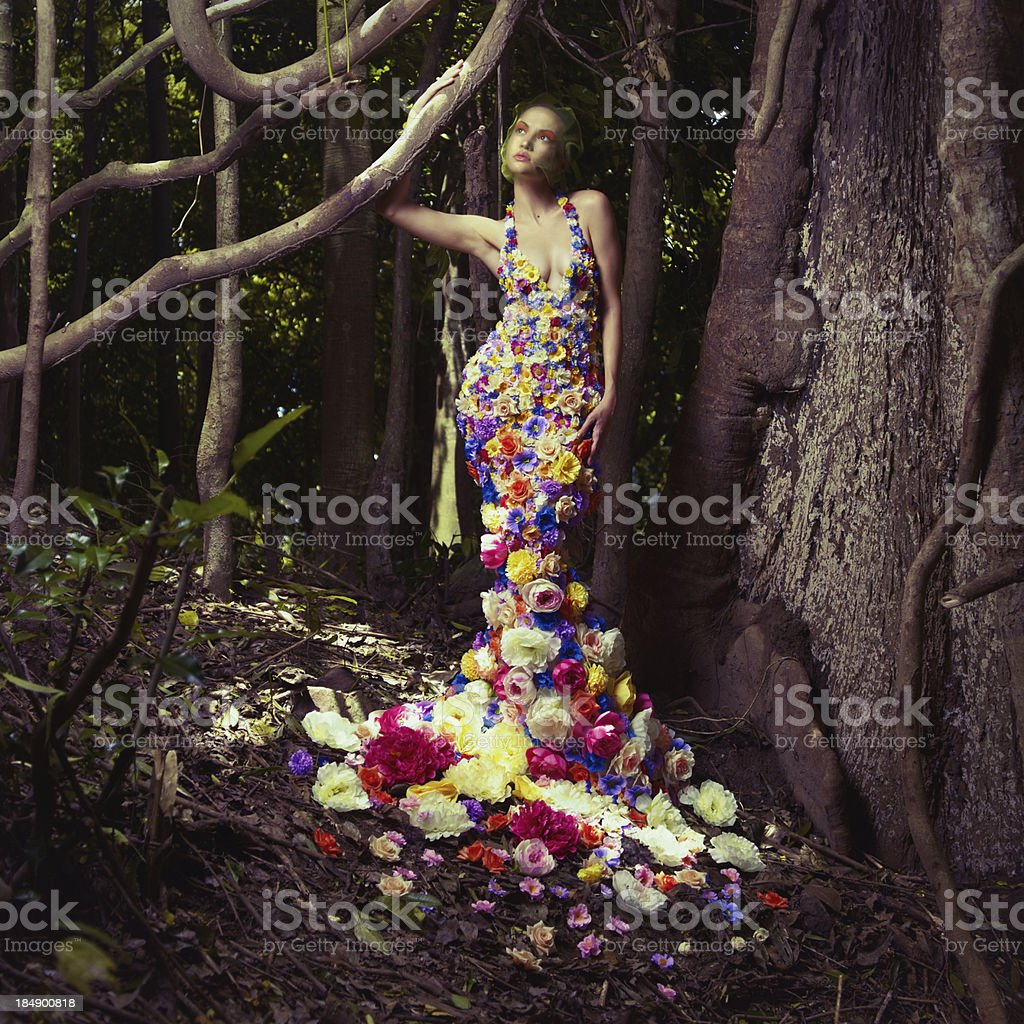 What man dressed with flowers in the forest stock photo