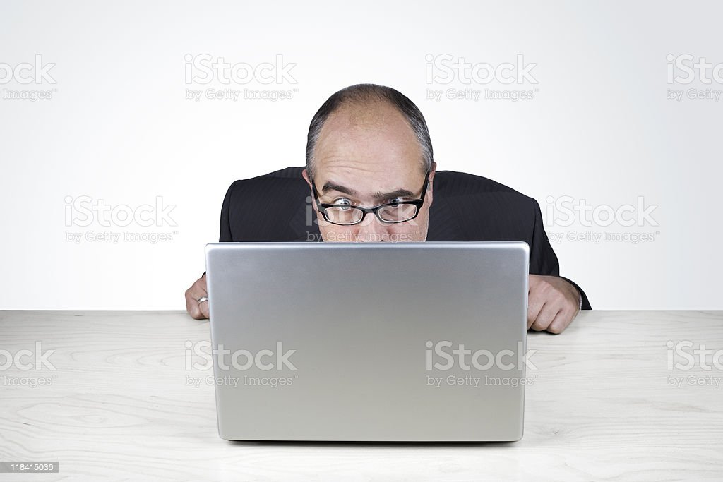 What?- Office worker looks doubtfully at his laptop stock photo