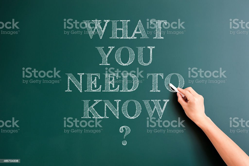 what you need to know written on blackboard stock photo