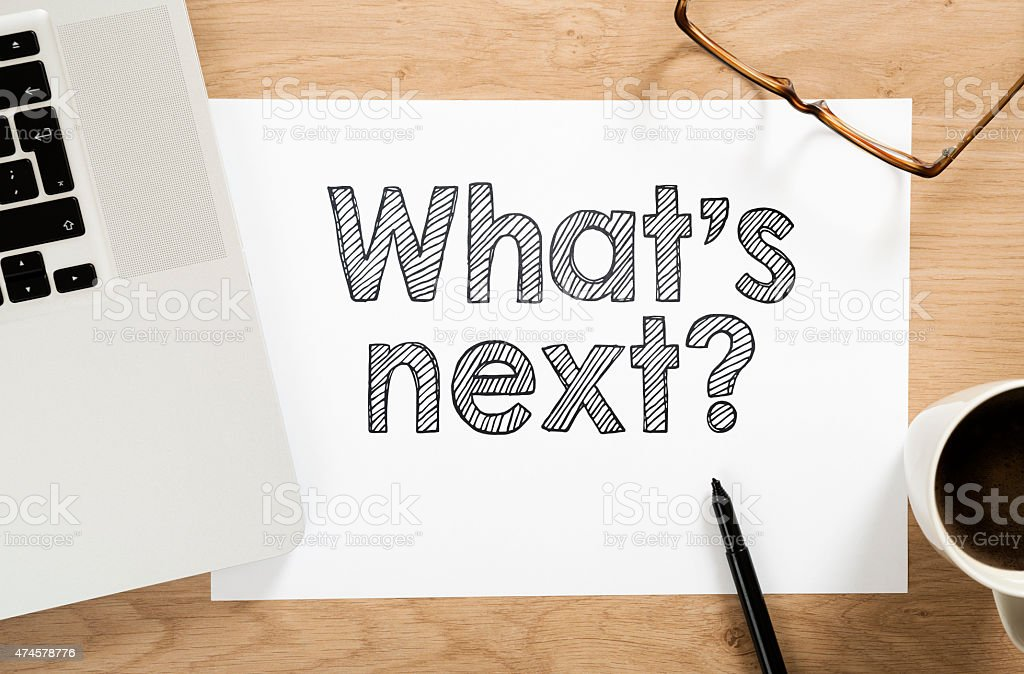 'what's next?' written paper on the office desk stock photo