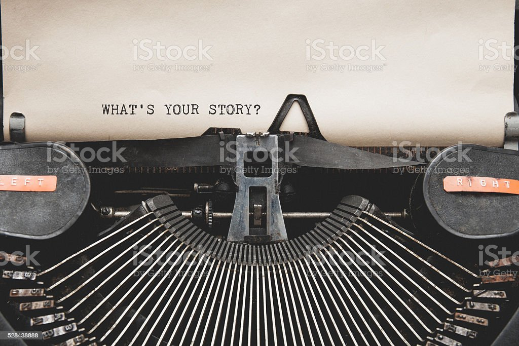 What's Your Story? question printed on an old typewriter. stock photo