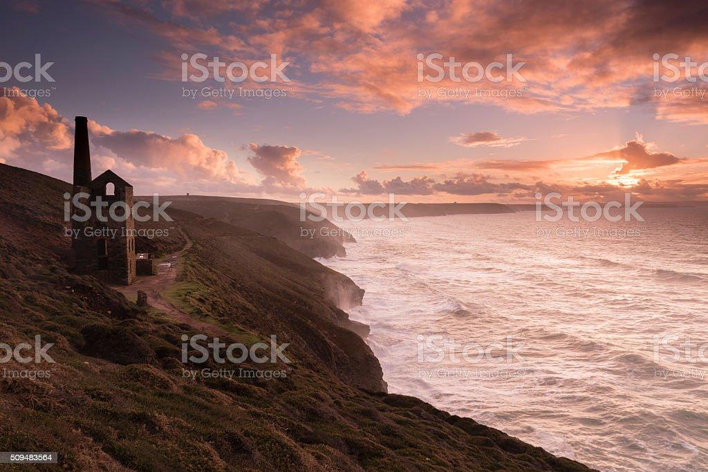 Wheal Coates abandoned tin mine on Cornish coast at sunset stock photo