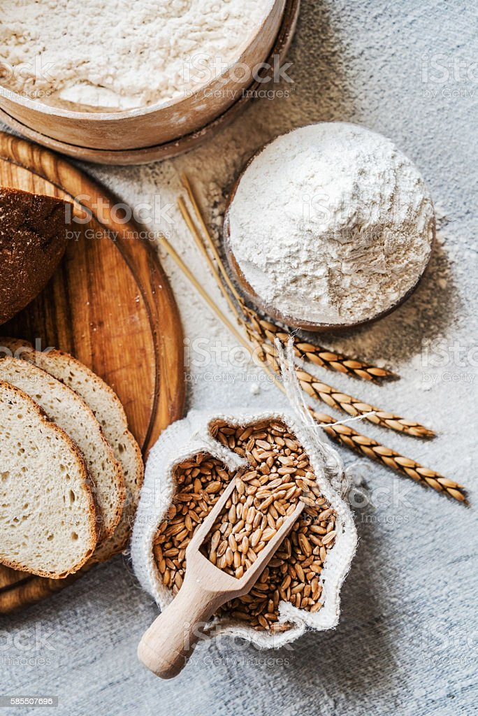 Wheat and flour on the table stock photo