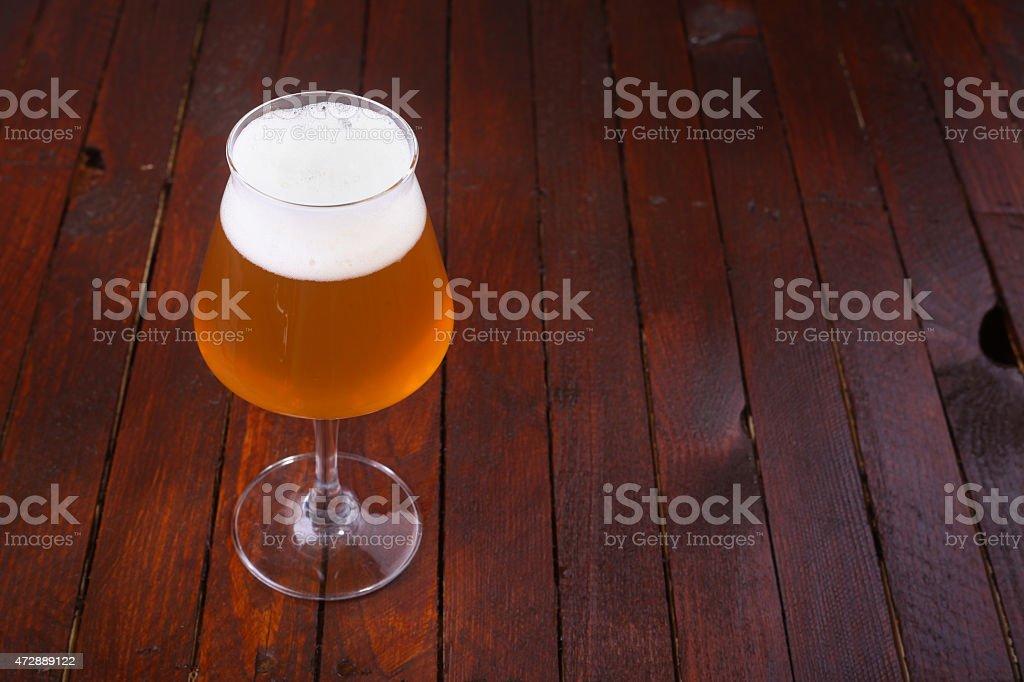 Wheat beer on wood stock photo
