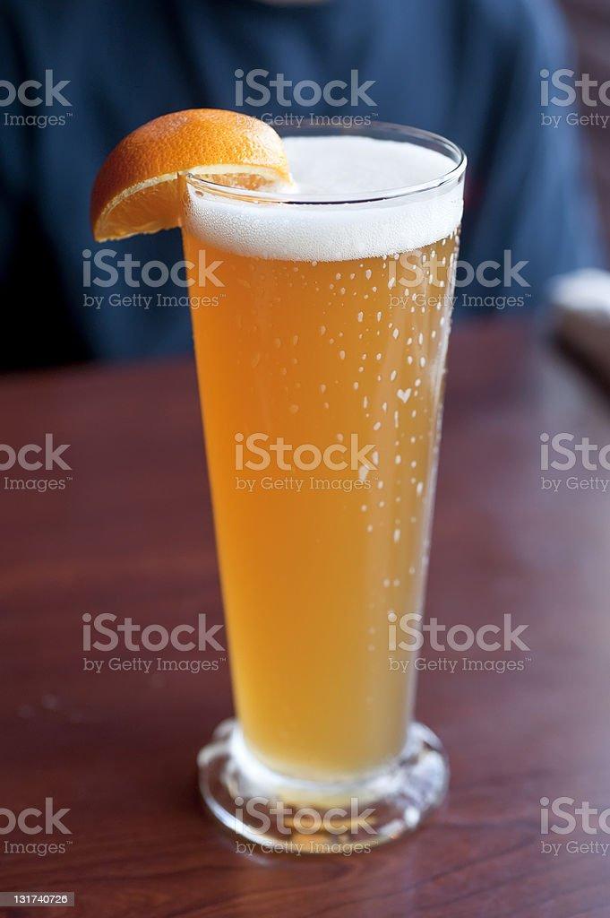 Wheat Beer with Orange Fruit stock photo