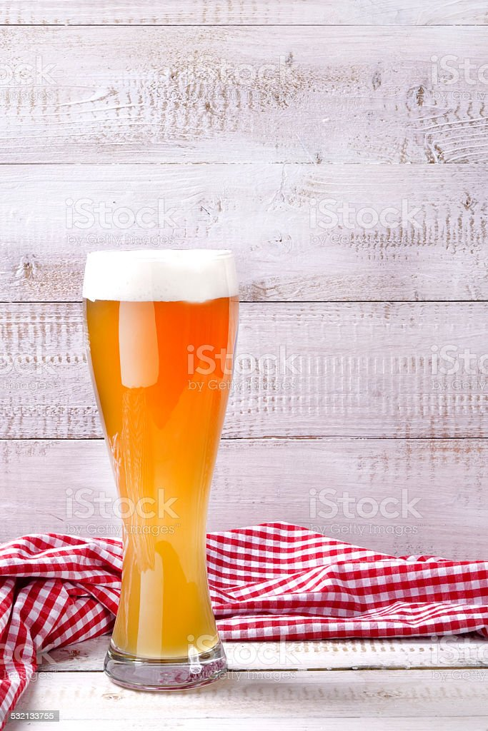 Wheat beer with red and white tablecloth stock photo