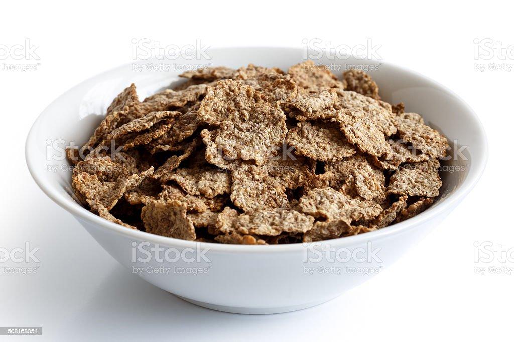 Wheat bran breakfast cereal in bowl. stock photo