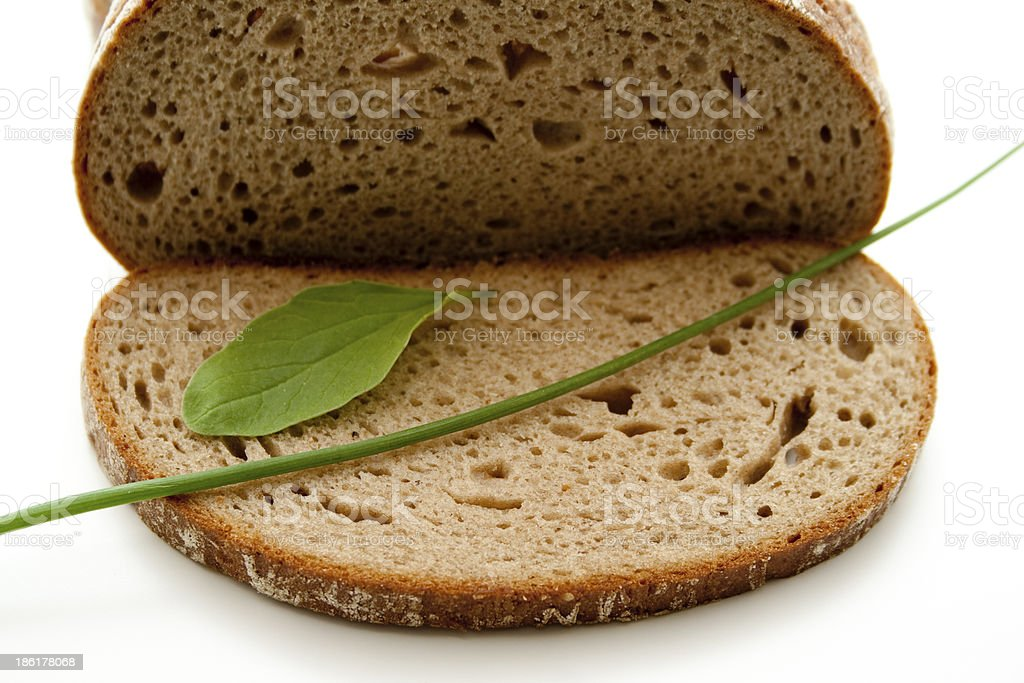 Wheat bread slices and leaf stock photo