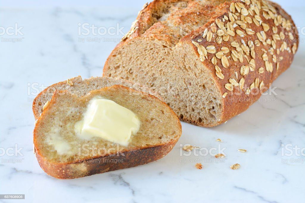 Wheat bread with butter stock photo