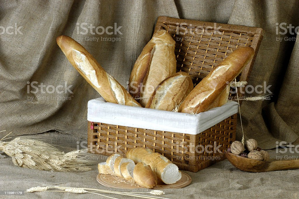 Wheat breads in a basket stock photo