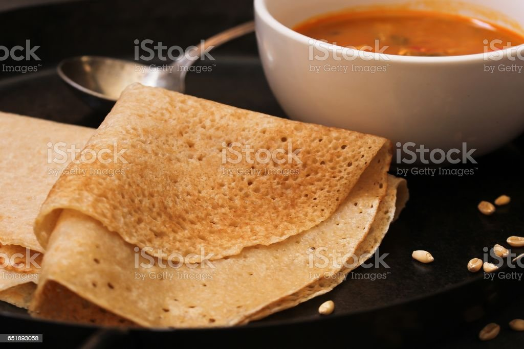 Wheat Dosa or Crepes served with sambar, selective focus stock photo