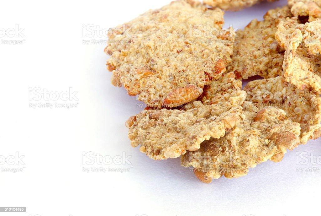 Wheat flakes on a white background. stock photo
