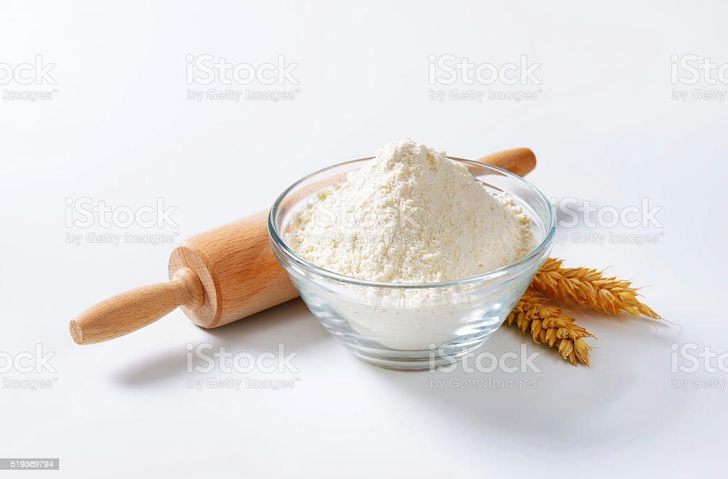 Wheat flour and rolling pin stock photo