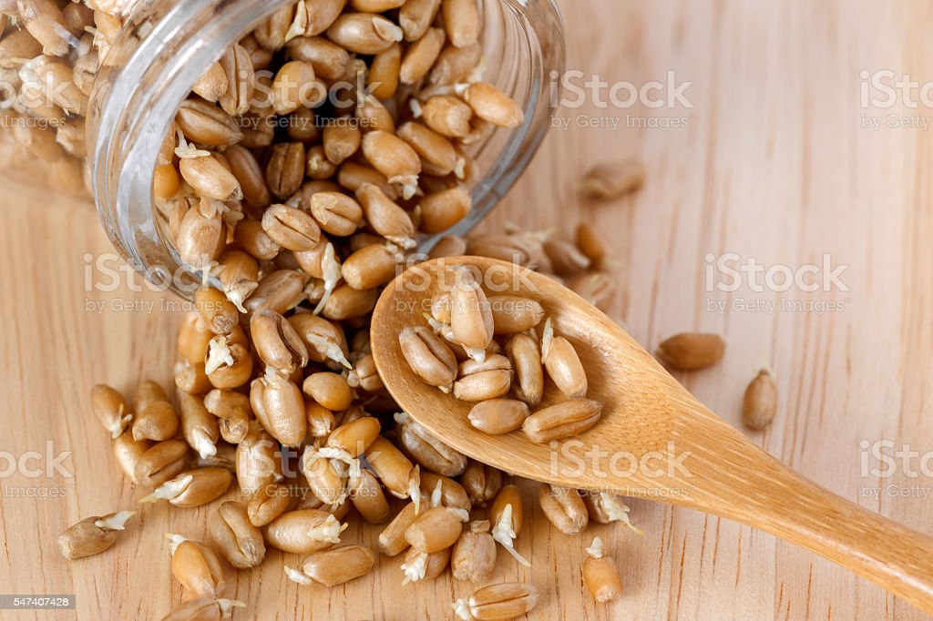 wheat germ in a glass jar on the wooden background stock photo