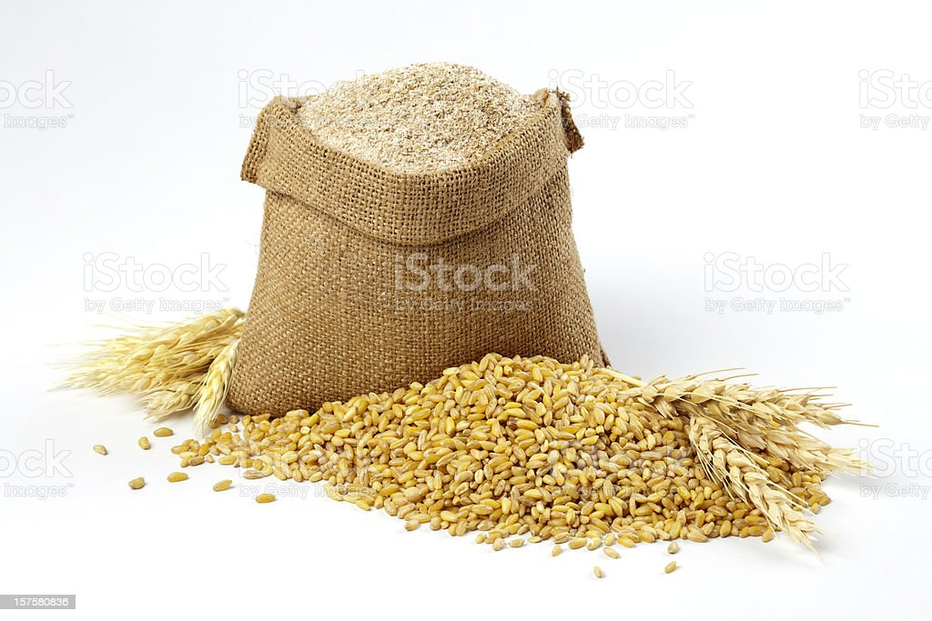Wheat grain and bran sack stock photo
