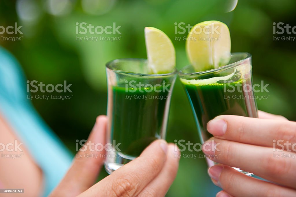 Wheat grass shot cheers stock photo
