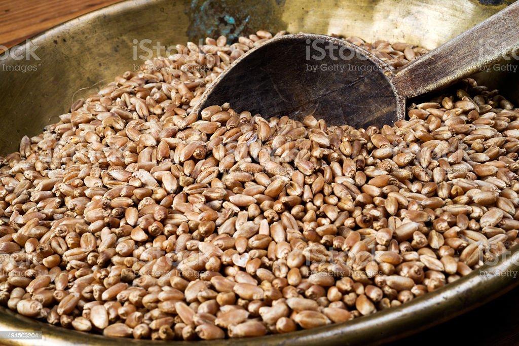 wheat in copper tray stock photo