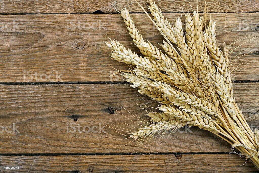 wheat on wood stock photo