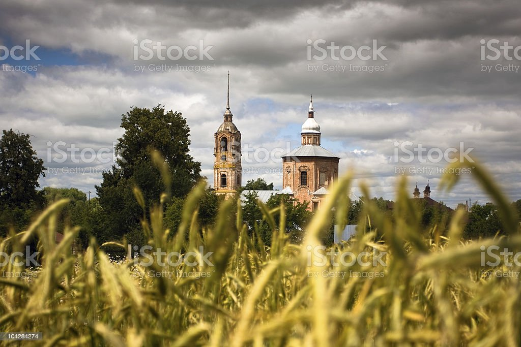 wheatfield and church in russian countryside royalty-free stock photo